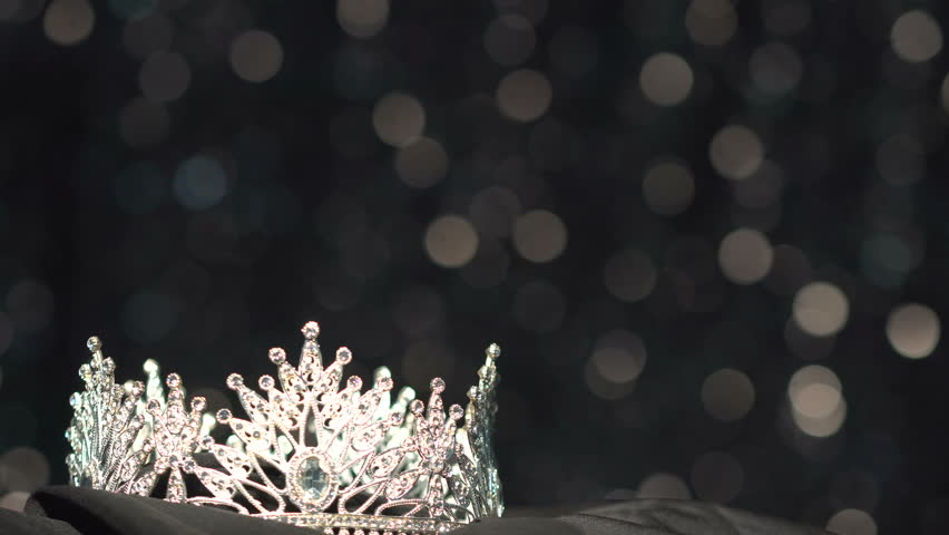 Diamond Silver Crown for Miss Pageant Beauty Contest, Crystal Tiara jewelry decorated gems stone and Bokeh sparking smoke abstract dark background, Slider moving left to right copy space for text logo
