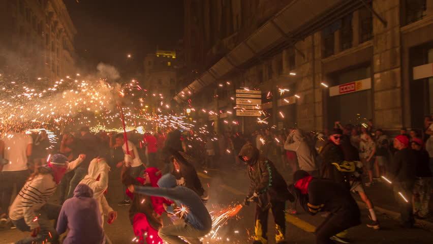 Barcelona, Spain - September 22, 2018 : Crowds in the street for the fire run, correfoc during la merce festival, barcelona spain | Shutterstock HD Video #1016761378