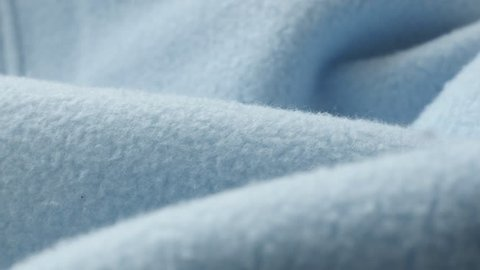 Shallow DOF blue blanket made of polar fleece 4K panning footage