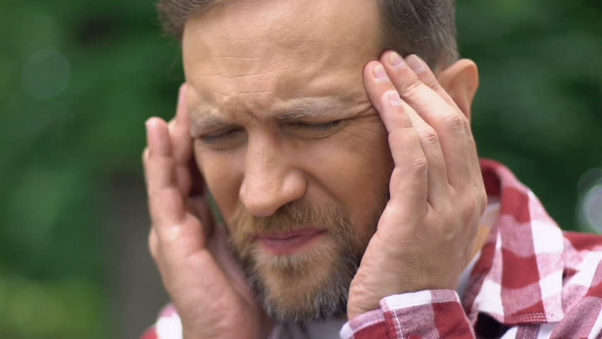 Male taking off glasses and massaging temples, headache, needs painkillers | Shutterstock HD Video #1016804548