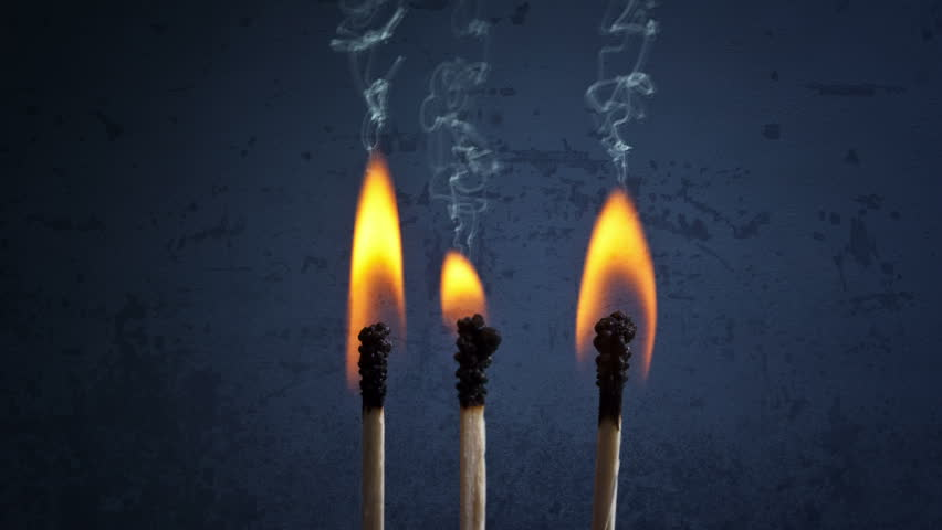 CINEMAGRAPH - Matchsticks with flame and smoke over a dark grunge background. | Shutterstock HD Video #1016822638