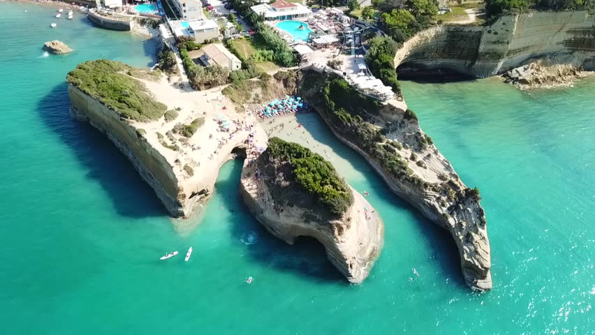 Aerial drone bird's eye view video of iconic white rock volcanic formations of Canal d' Amour in Sidari area, North Corfu island, Ionian, Greece