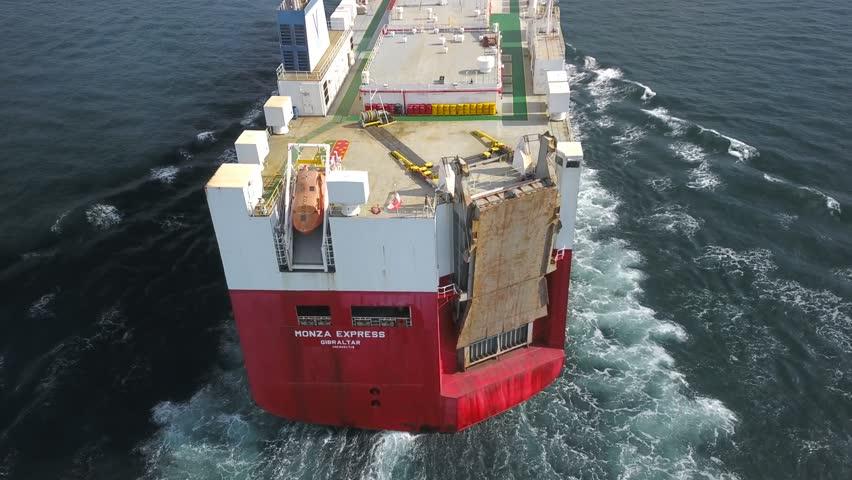 ISTANBUL - SEP 22, 2018: Close following the Ro-Ro ship from behind. Dutch Vroon's car carrier Monza Express (Flag: Gibraltar) cruising towards Bosphorus Sea