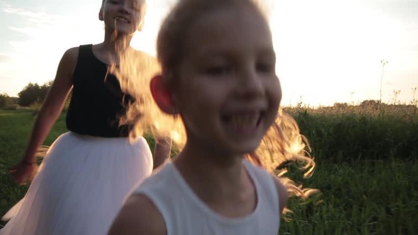 children girl running across the field #1017035068