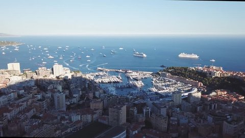 Monaco harbour & Monte Carlo during the yacht show summit, aerial view by drone