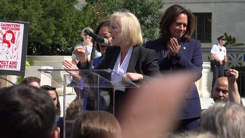 """WASHINGTON, DC - SEPT 28, 2018: Sen. Kirsten Gillibrand """"Our voices will matter.  .. November is coming!"""" rally at Supreme Court against Bret Kavanaugh nomination for justice. Sen. Kamala Harris also."""