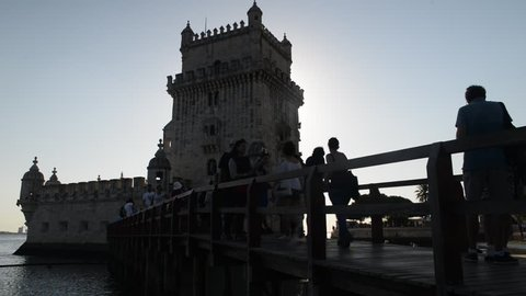 Belem, Portugal - Sept 23, 2018: Backlit tourists at Belem Tower, or the Tower of St Vincent, a fortified 17th-century tower in Belem, Lisbon, Portugal