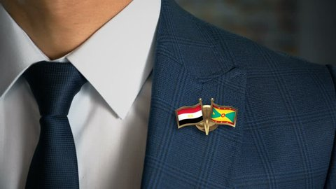 Businessman Walking Towards Camera With Friend Country Flags Pin Egypt - Grenada
