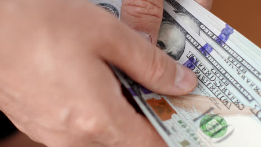 Male hands counting money cash in office close-up. Cash credit in dollar currency.   Shutterstock HD Video #1017221428
