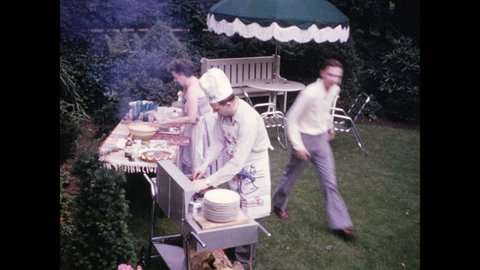 1940s: Man in chef's apron and hat tends to barbecue; guests socialize in lawn chairs.