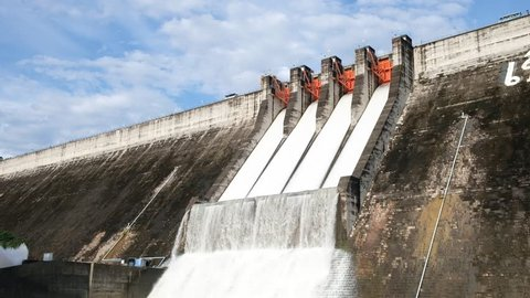Dam water release because the excess capacity of the dam until spring-way overflows.