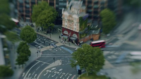 Timelapse of traffic outside Elephant and Castle Underground station in London from above. Tilt shift miniaturising effect.