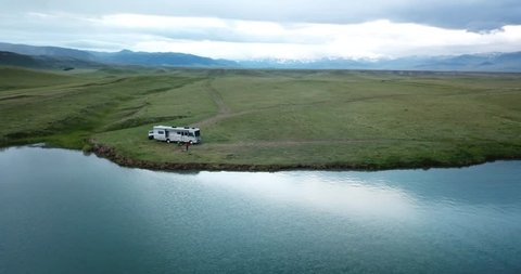 Aerial over lake reservoir remote boondock camping - Wyoming near Yellowstone National Park