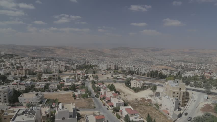 Amman is the capital and most populous city of Jordan, political and cultural center. Panning shot from top of high building