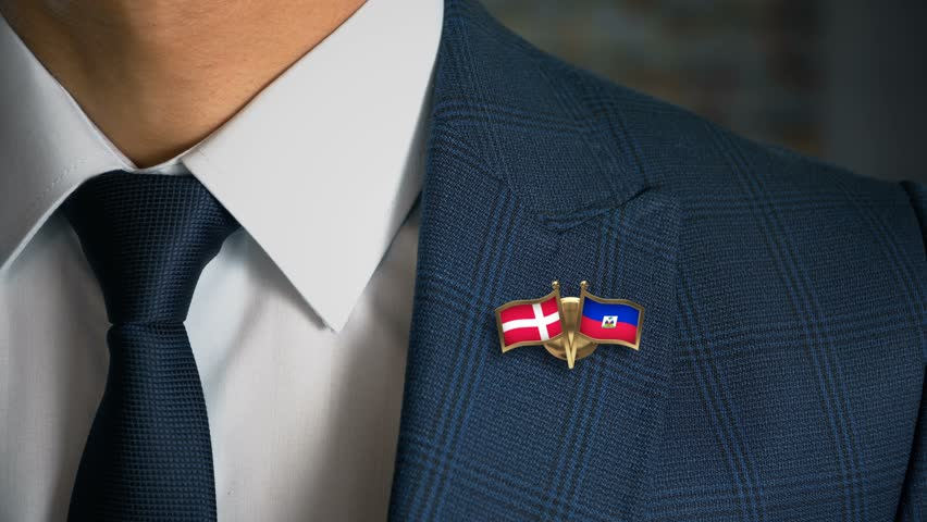 Businessman Walking Towards Camera With Friend Country Flags Pin Denmark - Haiti