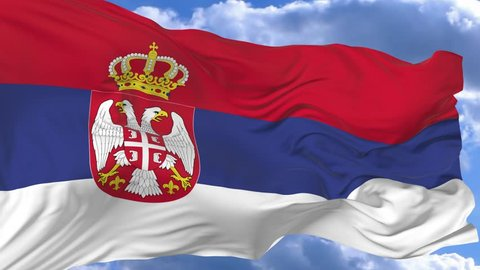flag waving in the wind against the blue sky Serbia