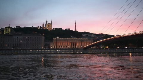 Boat navigating on the Soane at night in Lyon, France
