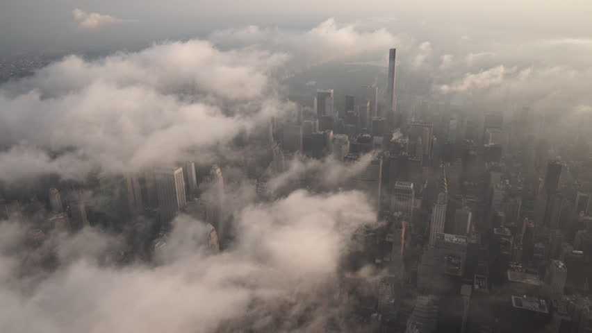 New York City Circa-2015, aerial view flying over Midtown Manhattan skyscrapers under fog and low level clouds at sunrise | Shutterstock HD Video #1017554038