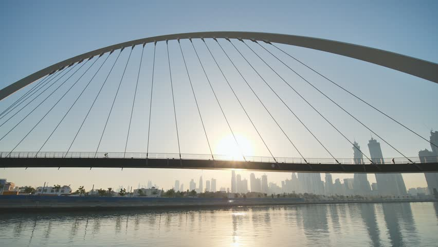 Dawn on the background of the bridge in the Dubai Greek area. #1017600028