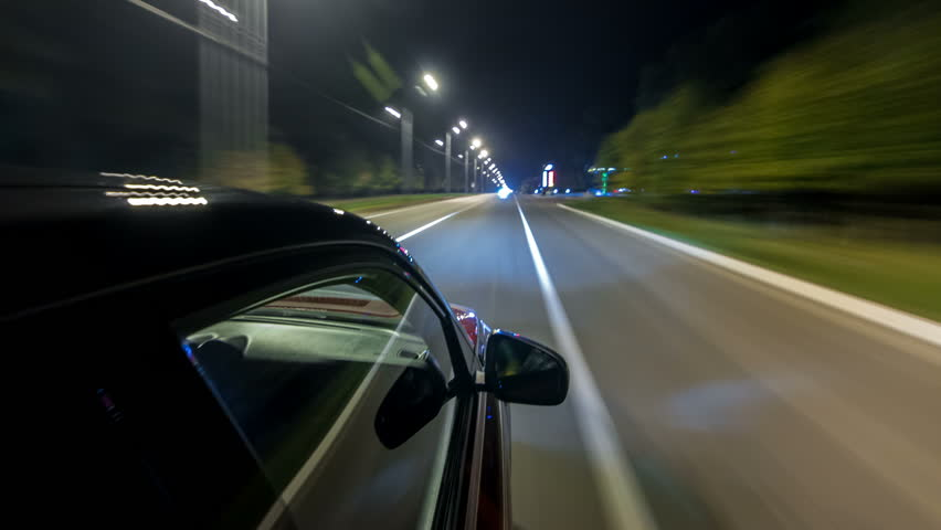 Drivelapse from top side of Car moving on a night highway timelapse hyperlapse, road with lights reflected on car on high speed. Rapid rhythm of a modern city. | Shutterstock HD Video #1017600628