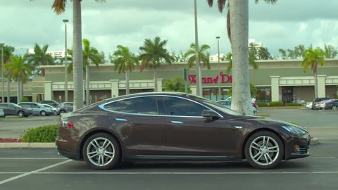 MIAMI, FL, USA - OCTOBER 8, 2018: Slow motion footage of a Tesla Model S in a parking lot