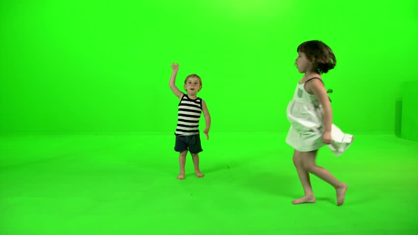 Two cute little kids dancing and playing around happily over a green screen. | Shutterstock HD Video #1017648958