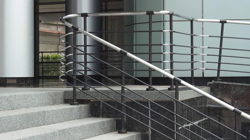 Fit businesswoman walking down building steps | Shutterstock HD Video #1017737278