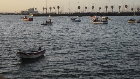 Early morning view of fishing boats on the marina and pier in Cascais, Portugal. Cascais is a popular summer vacation spot for Portuguese and foreign tourists