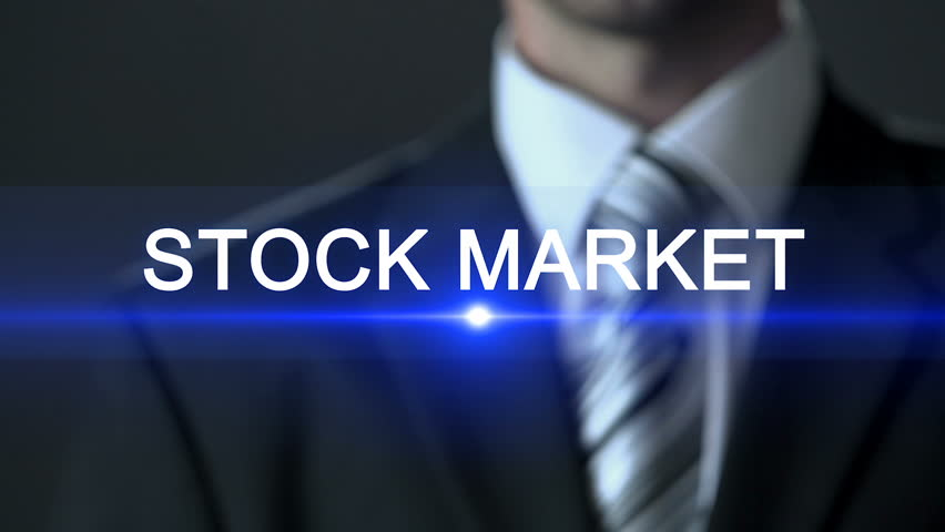 Stock market, male wearing official suit pressing buttons on screen, exchange | Shutterstock HD Video #1017822958