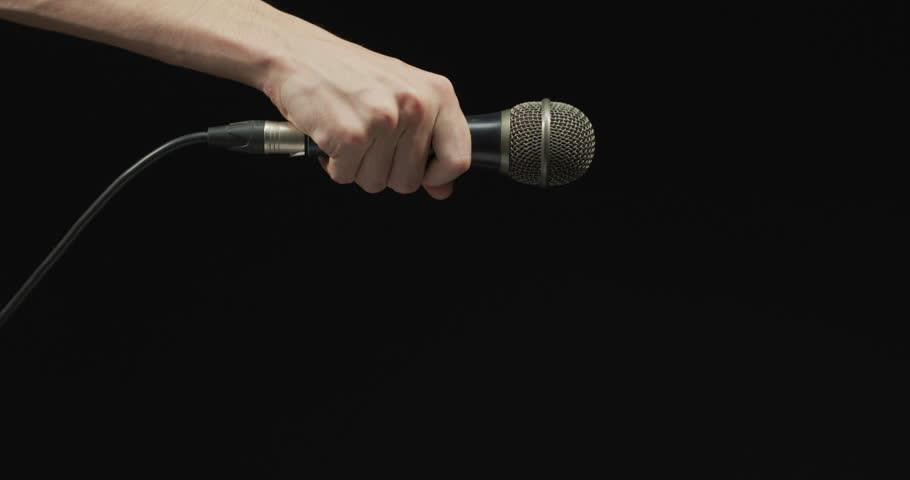 Hand dropping the microphone | Shutterstock HD Video #1017826228
