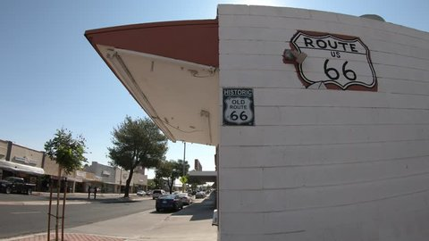 Barstow, California, USA - August 15, 2018:Historic Route 66 road sign on a white wall in Barstow, California, famous crossroads between Los Angeles and Las Vegas. Mother Road or Sixty Six background.