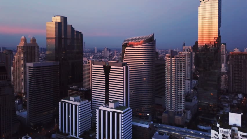 Aerial view of Chong Nonsi, Sathorn, Bangkok Downtown. Financial district and business centers in smart urban city in Asia. Skyscraper and high-rise buildings at sunset. | Shutterstock HD Video #1017851758