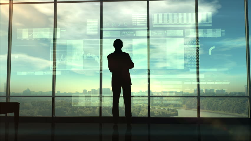 Silhouette of a trader in the office before infographics | Shutterstock HD Video #1017857938