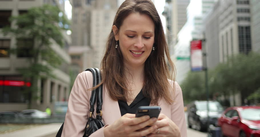 Business woman in city walking using cell phone | Shutterstock HD Video #1017902338