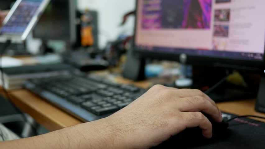 closeup of hand man clicking on mouse at office. #1017917848