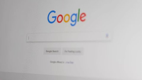 CHIANGMAI THAILAND, OCT 17, 2018: Businessman Searching on Google. Google is an American multinational corporation specializing in Internet-related services and products.