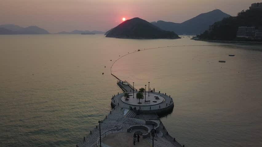Aerial bird eye view Photography viewpoint urban landscape sunset at Guanyin goddess statue Repulse bay , Hong Kong | Shutterstock HD Video #1018069108