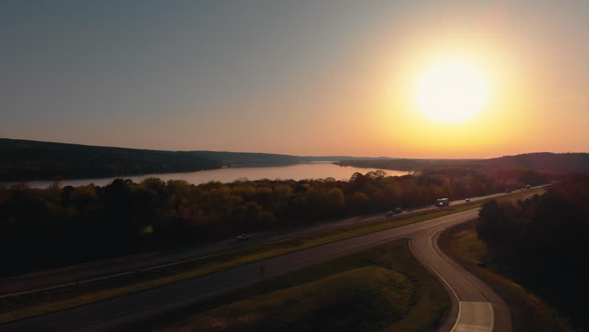 Aerial shot flying toward the Arkansas River and over Interstate 40 at sunset. | Shutterstock HD Video #1018088758