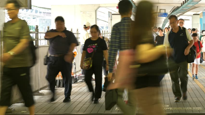 Timelapse of people moving along walk way in Hong Kong. | Shutterstock HD Video #1018164568