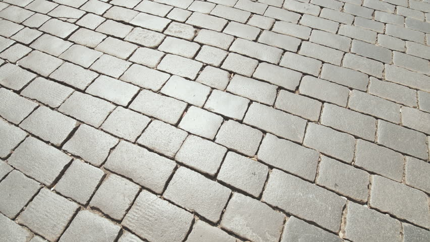 The road is made of stone bricks. Video in motion. | Shutterstock HD Video #1018192228