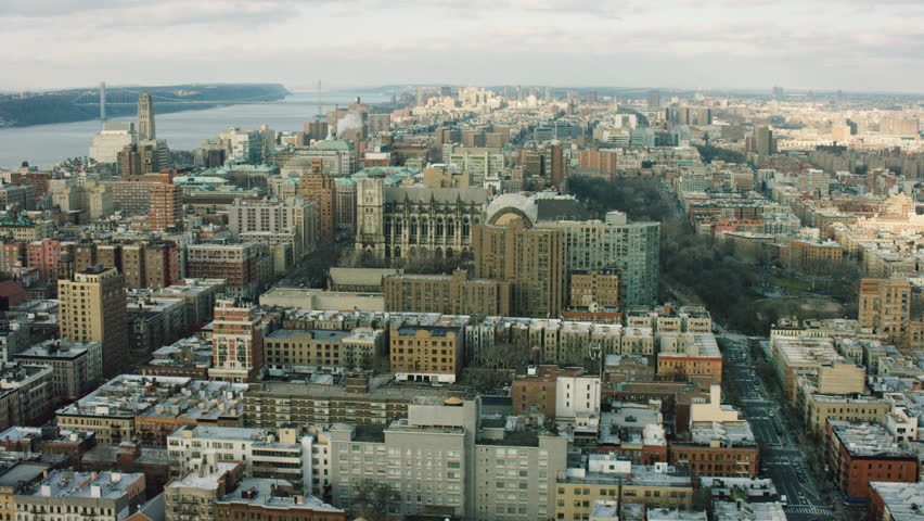 Aerial view of buildings near the Hudson River in Upper Manhattan, New York City, dim day lighting. Wide shot. 4k shot with a RED camera.