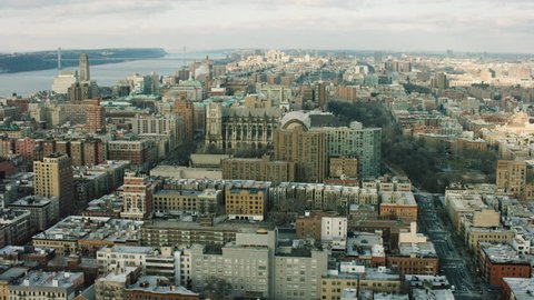 Aerial view of buildings near the Hudson River in Upper Manhattan, New York City, dim day lighting in winter. Wide shot. 4k shot with a RED camera.