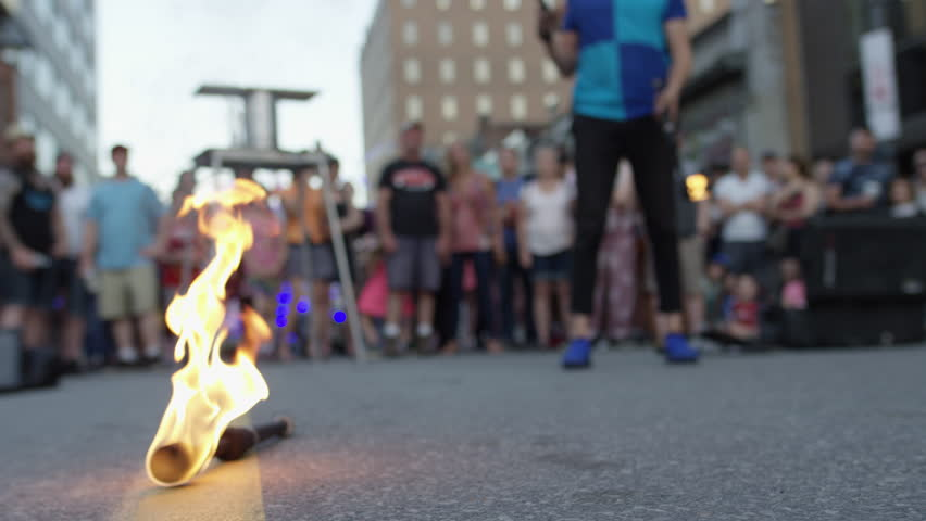 Ottawa, Ontario / Canada - 06 25 2018: A juggler performs in front of a crowd at Ottawa's annual Glow Fest on Bank Street #1018267438