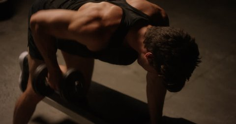 Overhead shot of strong male at gym doing reverse bent over row