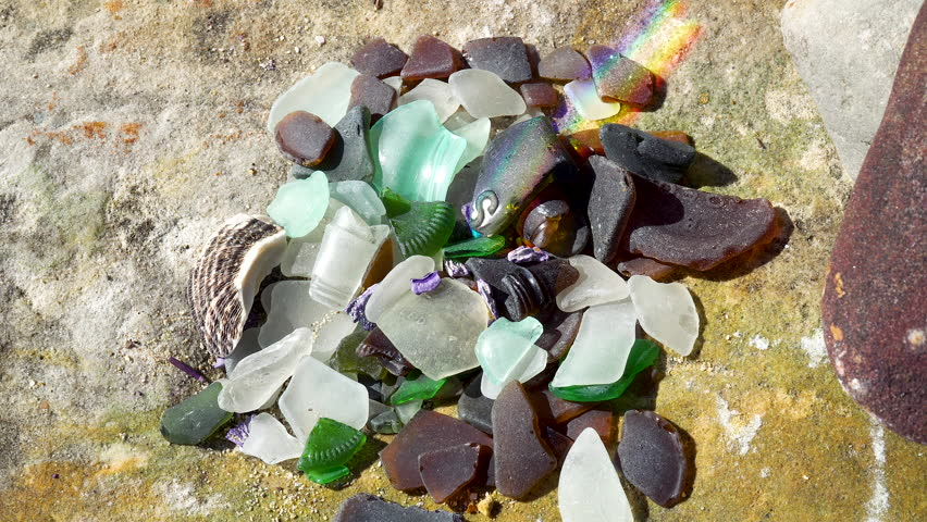 Close up multiple colored pieces of ocean glass at beach   Shutterstock HD Video #1018351228