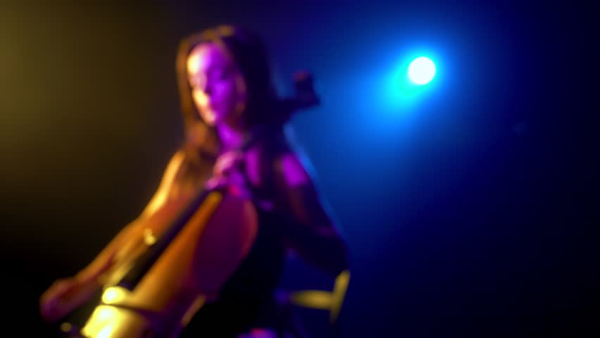 The cellist performs on stage.   Shutterstock HD Video #1018399438