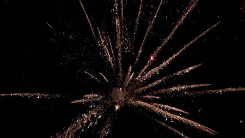 Close up of Multiple fireworks in beautiful night sky. Fireworks Display Celebration from above, Colorful Firework top view in Night sky with colored slow motion fireworks on background.