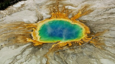Aerial view of Yellowstone Midway geyser Basin hot mineral rich water vivid colors Yellowstone National Park Grand Prismatic Spring Wyoming USA RED WEAPON