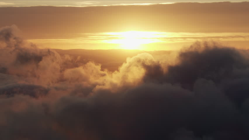 Aerial sunrise cloudscape view of Mt Moran summit above the clouds Grand Teton snowy mountain Range Rockies Yellowstone National Park Wyoming America RED WEAPON | Shutterstock HD Video #1018428238