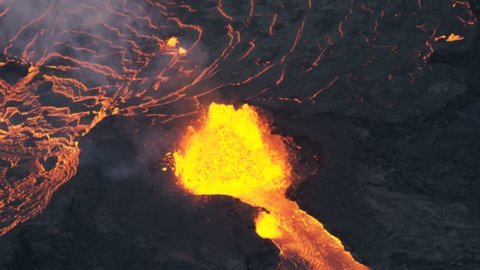 Aerial view of red hot magma erupting skywards from the earths crust with lava rock cooling and solidifying natural phenomenon RED WEAPON